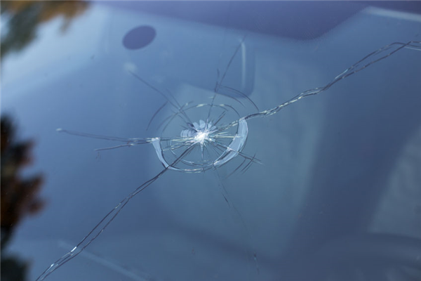 If a Rock Flies Off a Passing Truck, Can You Hold Them Accountable for Windshield Repair?